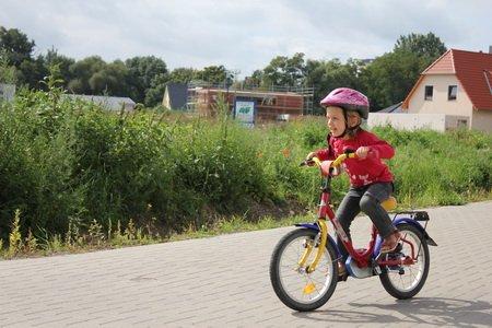 Kind und Rad
